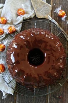 Pumpkin Truffle Bundt Cake with Chocolate Ganache Recipe on twopeasandtheirpod.com Pumpkin bundt cake with chocolate ganache and a tunnel of pumpkin spice truffles inside! The BEST pumpkin cake recipe!