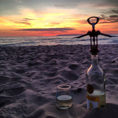Best date ever! Watching the sunset on the beach while enjoying some wine, no one around.