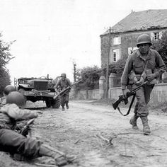 Soldiers of 314th Infantry Regiment, 79th U.S. Infantry Division are engaged in combat in a street in the French town of La Haye-du-Puits. Soldier on the right is armed with a Browning automatic rifle, you can also see the Willys jeep in the background. #dday #ww2 #wwii  #france #normandy #operation #overlord #bar #garand #thompson #jeep #europe #1944 #airborne #rangers