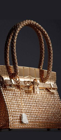 Wow. Vintage Hermès Birkin in rose and white gold, featuring 2,712 diamonds totaling 89.22ct!! #Beautyinthebag #bags @designer #luxury