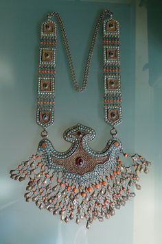 Tumor amulet; necklace; silver, coral, turquoise and carnelian.