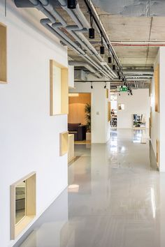 """MFRMGR has subdivided this office space in Poland to create individual workspaces for employees within wooden cabins designed to look like a """"mini-town"""""""