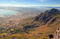 """""""Why is it you can never hope to describe the emotion Africa creates? You are lifted. Out of whatever pit unbound from whatever tie released from whatever fear. You are lifted and you see it all from above."""" -Francesca Marciano    New post on the blog all about Table Mountain and it's incredible views! Link in profile.    #travelingtexanblog #travelblogger #travelblog #tablemountain #capetown #campsbay #lionshead #signalhill #southafrica #westerncape #devilspeak #12apostles #africa…"""