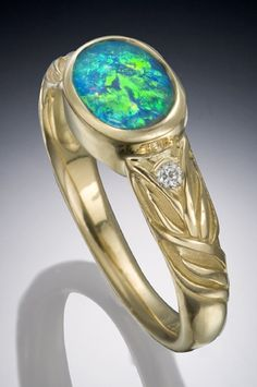 Opal and diamond ring in 18K yellow gold by Conni Mainne
