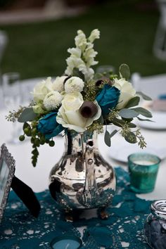 Idea inspiration: instead of silver pitcher, do mercury/ splotchy gold. Love the silhouette of the bouquet; trade out teal for coral or peach flowers