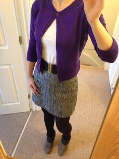 Silver and black skirt with parallel lines, black and silver waist belt, white top, purple cardigan, grey ankle boots