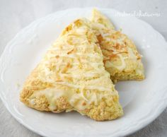 Orange Coconut Scones with Orange Glaze. A yummy tropical breakfast treat! #scones #recipe creationsbykara.com