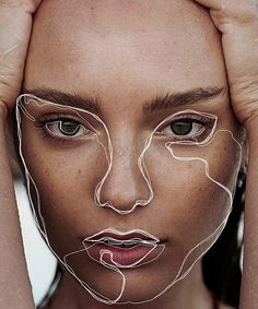 Photoshop in lines of cosmetic surgery on half a portrait