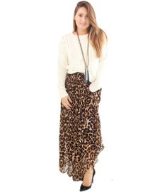 Everyone loves cheetah print! This punchy maxi is great for pairing with both a chunky sweater for fall, or an elegant black crop or blouse. Lined and pleated.   By LucyParis  Dry Clean Only  100% Polyester