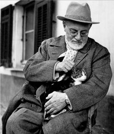 Henri Matisse (1869-1954) enjoying an afternoon break from painting with his cat, Minouche, at his apartment and studio in Nice.