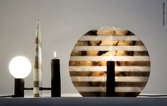 "Opus Varium by Davide G. Aquini is a table lamp inspired by the black-and-white decor that characterizes the Tuscan architecture such as the Cathedral of Volterra and its baptistery. This decoration is also used in the traditional alabaster technique called ""mosaico"", using light and dark mineral like cinerino and agate."