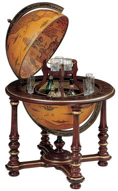 Fremont Globe Bar with Antique Globe BallThe luxury Fremont Globe Bar with Antique Globe Ball is a crown jewel of the bar globe range. The 5 pillars on which the globe ball rests are mahogany stained solid hardwood, as is the stand that j Man Cave Loft, Man Cave Home Bar, Globe Decor, Globe Art, Drinks Cabinet, World Globes, Wood Bars, Bars For Home, Houses