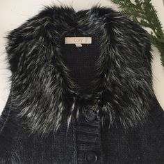 LOFT - Gray Vest + Fur Collar Luxuriously warm charcoal gray vest made of wool and acrylic blend (it's fuzzy by nature!) with a warm, faux fur collar. Two front slip pockets. All the lux of fur without the bulk! Looks great over a turtleneck. Great condition (Maybe worn once? Magnetic sensor still attached) LOFT Jackets & Coats Vests