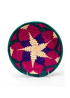 All Across Africa Jumbo Bowls: in East Africa, tradition of weaving baskets has been passed down from mother to daughter for centuries; now, All Across Africa helps women in Rwanda, Uganda, & Burundi gain economic independence by selling such baskets; couldn't think of a better gift for everyone