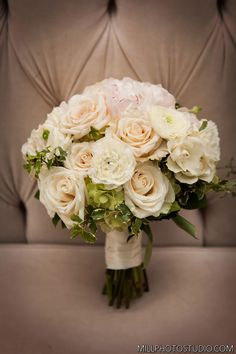 bridal bouquet i like this shape but i would only want white and ivory flowers