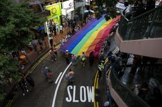 Participants hold a giant rainbow flag during a lesbian, gay, bisexual and transgender (LGBT) Pride Parade in Hong Kong November 8, 2014. Participants from the LGBT communities took to the streets on Saturday to demonstrate for their rights. (REUTERS/Tyrone Siu)