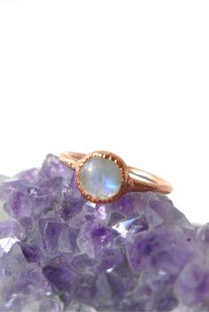 Blue flashes with rainbow moonstone on pure copper to highlight the sparkle. Open back organic setting so the light can shine through this magical stone. If you'd like your ring oxidized please leave