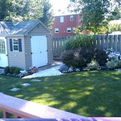An outdoor shed, trimmed to match the main house, gets its own garden and pathway, making it a backyard focal point.   thisoldhouse.com/yourTOH