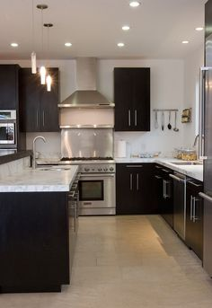 Dark cabinets, white counters & stainless steel appliances