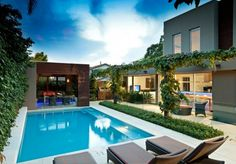 buying-a-house-with-a-pool-latest-swimming-pool-with-terrace-gray-sunbathe-chairs-planter-glass-railing-915x638.jpg (915×638)