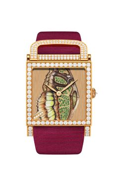 The one-of-a-kind DeLaneau Dôme Green Butterfly Wing automatic watch features a Grand Feu enamel dial set with tsavorites and diamonds. The iconic dôme red gold case is set with brilliant-cut diamonds, with additional on the buckle.