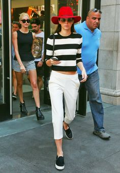 While in town for New York Fashion Week, Kendall dressed up a monochromatic look that she topped with a spicy red fedora. Her casual slip-on sneakers, loose white pants, and crop top felt simple and effortless but were still on-trend. The peek of midriff added a hint of sexiness that was almost too subtle to notice, and that's a good thing. Now scroll down and shop the look that will leave the style setters keeping up with you.