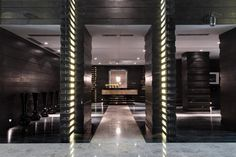 The designer opt out for a fancy marble floor set, that gets enhanced through the lighting structure in the center