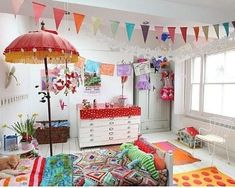 Colorful children's room decorated with papel picado, garland, and pennant banners.