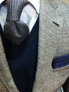 Classy:Silver silk knit tie, navy V-neck sweater, glen plaid jacket, blue pocket square; whereisthecool.com