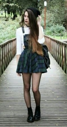 grunge-inspired: black beanie, plaid overall/skirt, white crop top, fishnets, doc martens. I would totally wear this outfit! Mode Outfits, Grunge Outfits, Winter Outfits, Grunge Dress, Summer Outfits, Punk Rock Outfits, Hipster Girl Outfits, Grunge Clothes, 90s Clothes