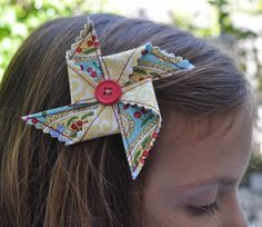 pinwheel hair clips- have a pretty good idea how to make these for K