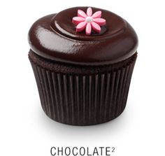 Valrhona chocolate cupcake with a whipped Callebaut chocolate frosting topped with a fondant flower