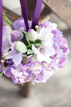 Lavender. white. green. hydrangea poms. Floral Designer: Lilies of the Field.