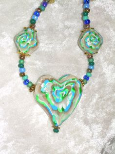 Teal and White Swirl Heart Necklace by ArabesqueArtsByDarcy, $60.00