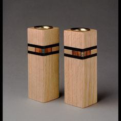 Candle holders are made of exotic and domestic woods with veneer dyed by the artist. Description from artfulhome.com. I searched for this on bing.com/images