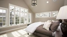 Master suite home addition with large Marvin Windows and vaulted ceiling