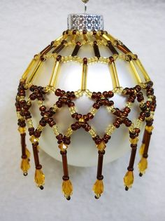 """This cover fits a standard size Glass Ball 2 5/8"""" Original design from the  House of Whispering Firs  """"Tapestry II"""".  This beaded cover is a combination of glass seed, bugle and faceted beads along with faceted drops"""