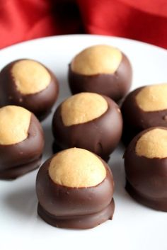 Buckeyes, also known as Peanut Butter Balls, have a smooth peanut butter center and a fun chocolate shell. Make this simple buckeye recipe for your Christmas treat trays. From @chocolatewgrace