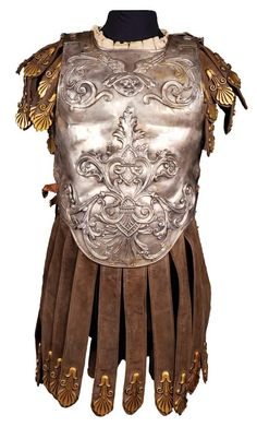 Hand-hammered and riveted, silvered-copper front and rear interlocking torso armor with black suede arm and groin tassels, finished with brass-colored decorations. Worn by Duncan Lamont as 'Marius' in Ben-Hur Helmet Armor, Arm Armor, Body Armor, Ancient Armor, Medieval Armor, Gladiator Costumes, Roman Armor, Duncan, Roman Legion