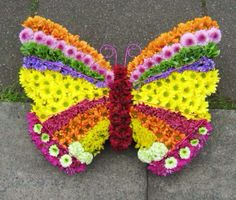 Butterfly funeral tribute - for the lover of nature, or maybe a younger cherish family member xx Funeral Floral Arrangements, Flower Arrangements, Butterfly Flowers, Flower Art, Butterflies, Funeral Tributes, Memorial Flowers, Flower Rangoli, Flower Festival