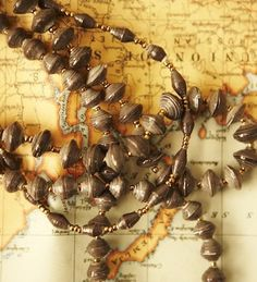 """Necklace from 31 Bits.  """"Add warm earth tones to your spring wardrobe with our three-strand, tiered necklace, Hatch. (All necklaces are made from recycled paper and are unique in their exact colors)."""""""