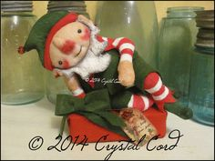 Elf doll laying on gift Christmas winter decor fantasy creepy cute red white whimsical country decor Farm Primitive HaFair OFGteam