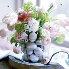 Use a wire egg basket to house this arrangment