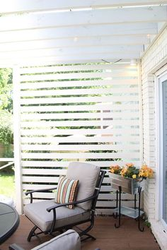 This slatted wall is a terrific way to add a little privacy and a lot of style to a patio or deck. Courtney Clymer of Lifestyled Atlanta styled this backyard deck makeover with a pergola, new patio furniture and cool outdoor lighting. See it on The Home D (outdoor porch lights decks)