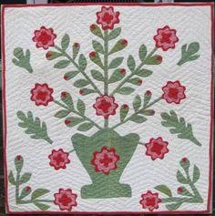 Floral Basket Applique Crib Quilt at www.antiquequilts.com/catalog6.htm#17544