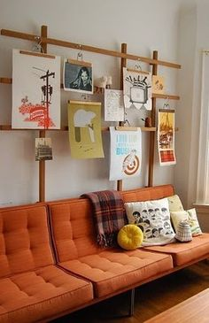 Old wooden pant hangers. Nice way to hang prints and they're easy to find at estate sales.