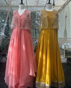 peach potli button jacket dress and yellow long dress with border and jacket Buy Designer Collection Online : Call/ WhatsApp us on : Indian Gowns, Indian Attire, Pakistani Dresses, Indian Outfits, Indian Anarkali, Indian Wear, Indian Designer Outfits, Designer Dresses, Stylish Dresses