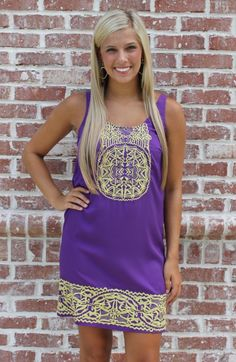 Joy Joy 4061PUR - LSU fans, this one is all for you! This shift dress is so cute, and the embroirdery is right on trend for this year. The hemline isn't super short, making it  great for our tall and short girls alike. The look is very flattering! Model is wearing an XS.