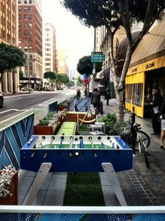 """The """"active"""" parklet contains a foosball table. The other contains a bar. (Sam Lubell / AN)"""