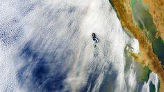 Optical Phenomenon, Glory, captured by the Moderate Resolution Imaging Spectroradiometer on NASA's Terra satellite, over Baja California.